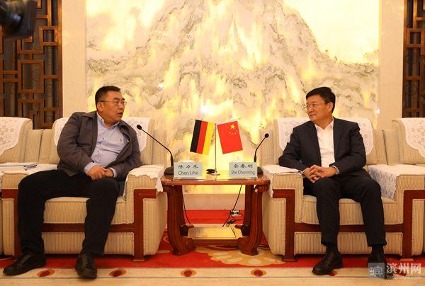 佘春明会见德国德赢科技公司董事陈力禾先生