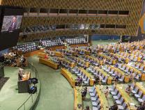"""人民日报钟声:联合国不是传播""""政治病毒""""的平台"""