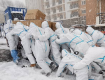 加油!風雪嚴寒里奮戰的中國人