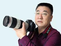 """无棣资深摄影师陈子庆获全国""""从事新闻工作三十年""""表彰"""