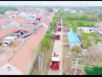阳信小村庄购30多台大型收割机助力三夏